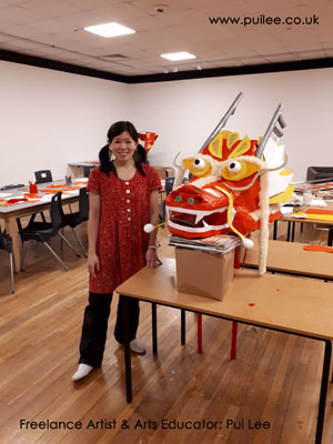 Artist Pui Lee and the finished giant dragon head