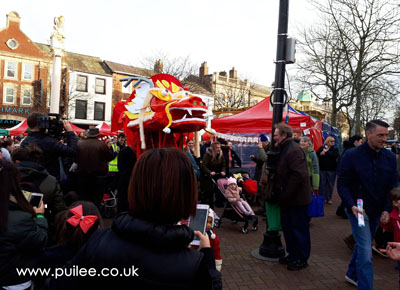 The giant dragon in the city centre parade
