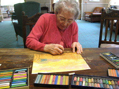 This is Jessie. She is 100yrs old and is working on her first ever pastel drawings! :-)