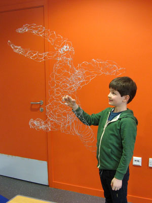 Look at this big funky wire dragon sculpture!