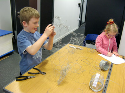 Working hard creating wire sculptures!