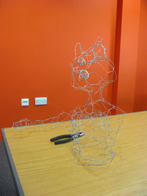 Look at this funky feline wire sculpture!