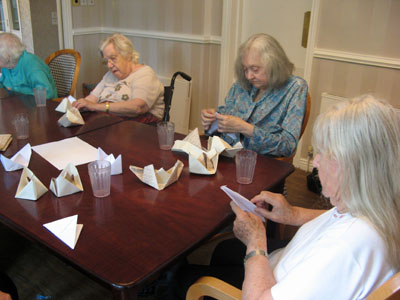 The residents have a go at creating some origami boats!