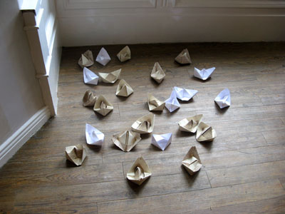 """Life Boat""(2012): origami boats installation; wallpaper, copier paper; dimensions variable"