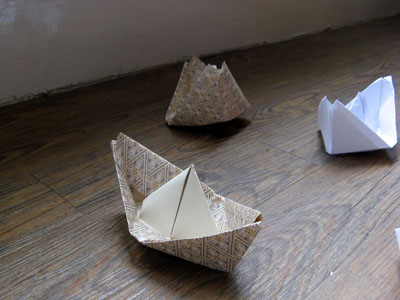 "Close-up of ""Life Boat""(2012): origami boats installation; wallpaper, copier paper; dimensions variable"